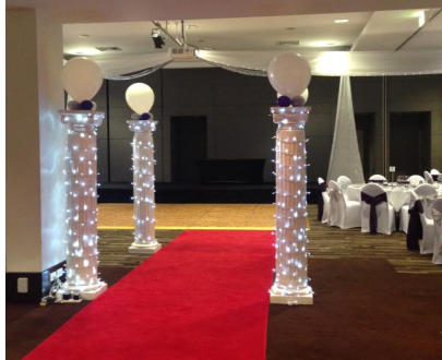 Hired red carpet and fairy lights make spectacular entry